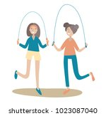two girls jumping rope. healthy ... | Shutterstock .eps vector #1023087040