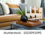 brown leather sofa near a... | Shutterstock . vector #1023091090