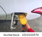 top view of attendant filling... | Shutterstock . vector #1023103570