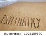 the word psychiatry written in... | Shutterstock . vector #1023109870