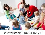 young moms with their kids | Shutterstock . vector #1023116173