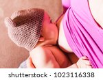 mother with her newborn baby | Shutterstock . vector #1023116338