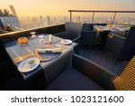 table setting on roof top... | Shutterstock . vector #1023121600