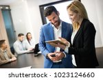 businesspeople discussing while ... | Shutterstock . vector #1023124660