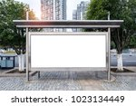 bus stop on city road edge... | Shutterstock . vector #1023134449