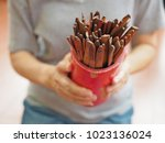 hands holding bamboo cylinder... | Shutterstock . vector #1023136024