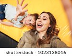 excited young mother playing... | Shutterstock . vector #1023138016