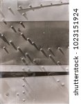 Small photo of abstract texture background of the metallic rivet airplane