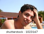 young man at the pool - stock photo