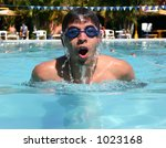 young man swimming - stock photo