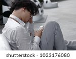 worried tired young asian...   Shutterstock . vector #1023176080