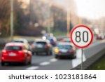 defocused image of speed limit... | Shutterstock . vector #1023181864