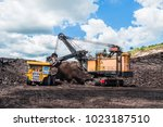 electric rope shovels loading... | Shutterstock . vector #1023187510