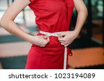 a young woman wearing a workout ... | Shutterstock . vector #1023194089