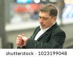 impatient traveler at station... | Shutterstock . vector #1023199048