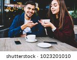 cheerful male and female teen... | Shutterstock . vector #1023201010