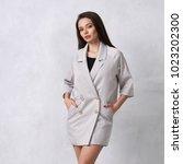 pretty female model wearing... | Shutterstock . vector #1023202300