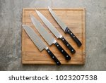 kitchen knives set laying on... | Shutterstock . vector #1023207538