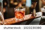 cocktails in the foreground on... | Shutterstock . vector #1023230380
