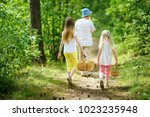 two cute little sisters hiking... | Shutterstock . vector #1023235948
