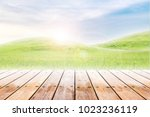 empty wood table top on mound... | Shutterstock . vector #1023236119