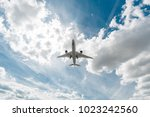 the big plane delivers... | Shutterstock . vector #1023242560