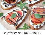 fig sandwiches on a wooden... | Shutterstock . vector #1023245710