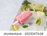 fruit ice cream popsicles.... | Shutterstock . vector #1023247618