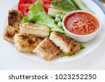 fried tofu with fresh salad.... | Shutterstock . vector #1023252250