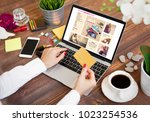 woman shopping online | Shutterstock . vector #1023254536
