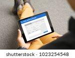 man applying for visa online | Shutterstock . vector #1023254548