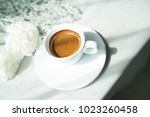 cup of espresso coffee and... | Shutterstock . vector #1023260458