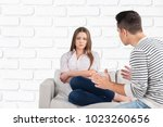 sad couple on sofa | Shutterstock . vector #1023260656