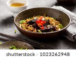 asian noodle dish with beef and ... | Shutterstock . vector #1023262948
