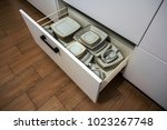 open kitchen drawer with plates ... | Shutterstock . vector #1023267748