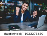 cheerful hipster guy looking at ... | Shutterstock . vector #1023278680