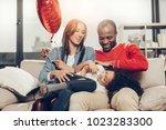 young parents enjoying weekends ... | Shutterstock . vector #1023283300