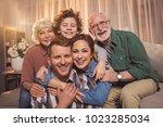 portrait of cheerful wife... | Shutterstock . vector #1023285034