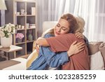 happy young female embracing... | Shutterstock . vector #1023285259
