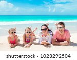 happy beautiful family on white ...   Shutterstock . vector #1023292504