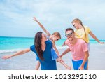 happy beautiful family on white ...   Shutterstock . vector #1023292510