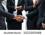 team leaders shaking hands... | Shutterstock . vector #1023305488