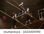 air gymnasts in the circus | Shutterstock . vector #1023305590