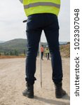 Small photo of Surveyor engineer is measuring level on construction site. Surveyors ensure precise measurements before undertaking large construction projects.
