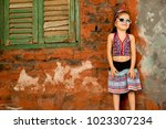 cute girl child wearing... | Shutterstock . vector #1023307234