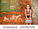 cute girl child wearing... | Shutterstock . vector #1023307240