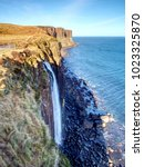Small photo of Kilt Rock Waterfall in winter midday. Kilt rock coastline cliff and waterfall in Scottish highlands, Scotland, United Kingdom