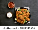 tasty crispy chicken wings with ... | Shutterstock . vector #1023331516