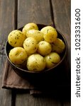 boiled potatoes with dill in... | Shutterstock . vector #1023331600