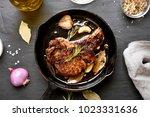fried pork steak in frying pan... | Shutterstock . vector #1023331636
